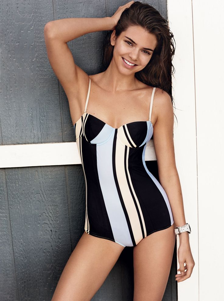 In the Swim - Graphic lines, a demi-cup, and a low-cut leg can turn even the bikini faithful into flag-flying fans of the one-piece maillot. Dolce & Gabbana swimsuit, $675; select Dolce & Gabbana boutiques. Chopard bracelet; Chopard boutiques. Timex watch, $70; timex.com.