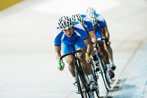 Stock Photo : Track cycling team riding in velodrome