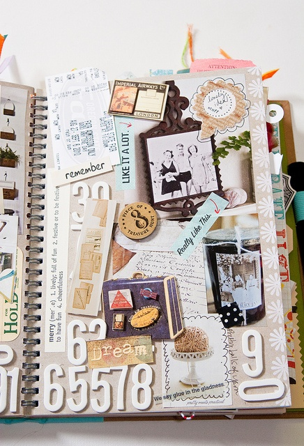 smash another cute book idea, put together a page of mementos from a trip or experience, frame it and hang it in the wall
