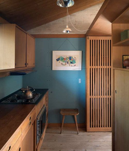 Not usually a fan of cool colored rooms, but I really like this blue - the cabinets are even more beautiful!