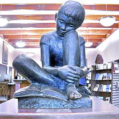 "Reading Boy  --  sculpture by Sylvia Shaw Judson - the same as did the 'bird girl' statue, well known from the book cover of ""the Garden of Good and Evil""."