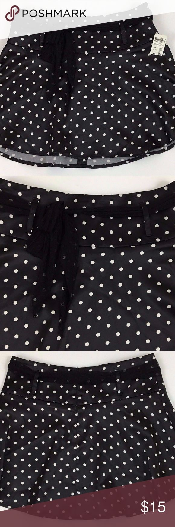Taunt Black and White Polka Dot Mini Skirt Taunt Women's SEXY Black and White Polka Dot Mini Skirt with Sash Belt Size XS New with Tags  Style: Cute Black and White Women's Miniskirt by Taunt (Made in the USA)  Color: Black and White   Size: XS  Measurements: Waist Flat 15 Inches, Hip Inseam 14.75 Inches, Overall Length 15.5 Inches, Zipper length 6 inches   WTA-120 Taunt Skirts Mini