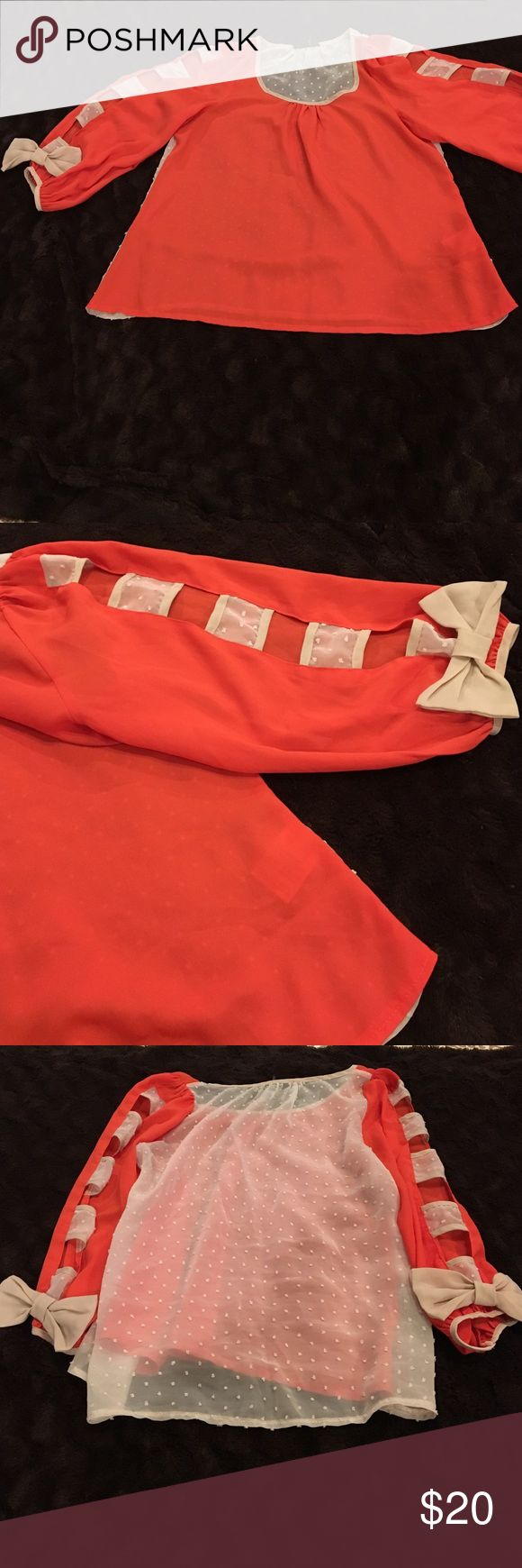 Boutique top Boutique top with detailing. Must wear a cami underneath. Open sleeves with bows at end. 3/4 length sleeves. Front is burnt orange and back is cream/tan. Very cute with denim skinnies! Size Medium. Smoke-free, pet-free home. Tops Blouses