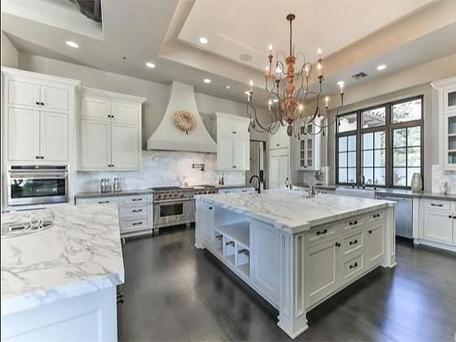 Britney Spears' California Mansion Is Giving Us Serious Real Estate FOMO | THE KITCHEN | Bright and airy, the all-white, grand kitchen includes marble countertops, state-of-the-art appliances, two islands and a spacious butler's pantry.