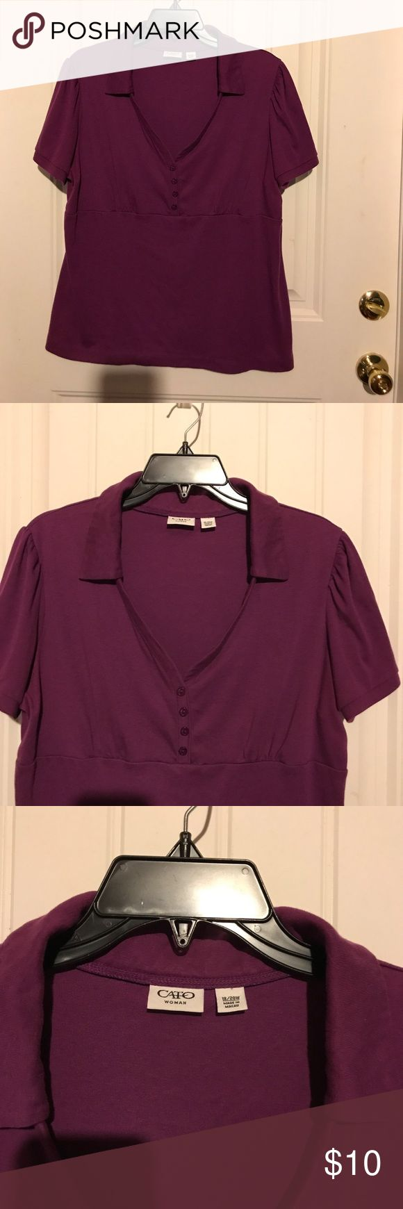 Cato Woman Purple Polo Shirt Empire Waist 18/20W Cato Woman Purple Polo like Shirt is size 18/20W. If you're busty this may not fit you. The Empire Waist went up on me higher than it should have. I like the v-neck, collar and 4 decorative buttons. Short sleeves top was made in Macau of 60% cotton 40% polyester. Cato Tops Tees - Short Sleeve
