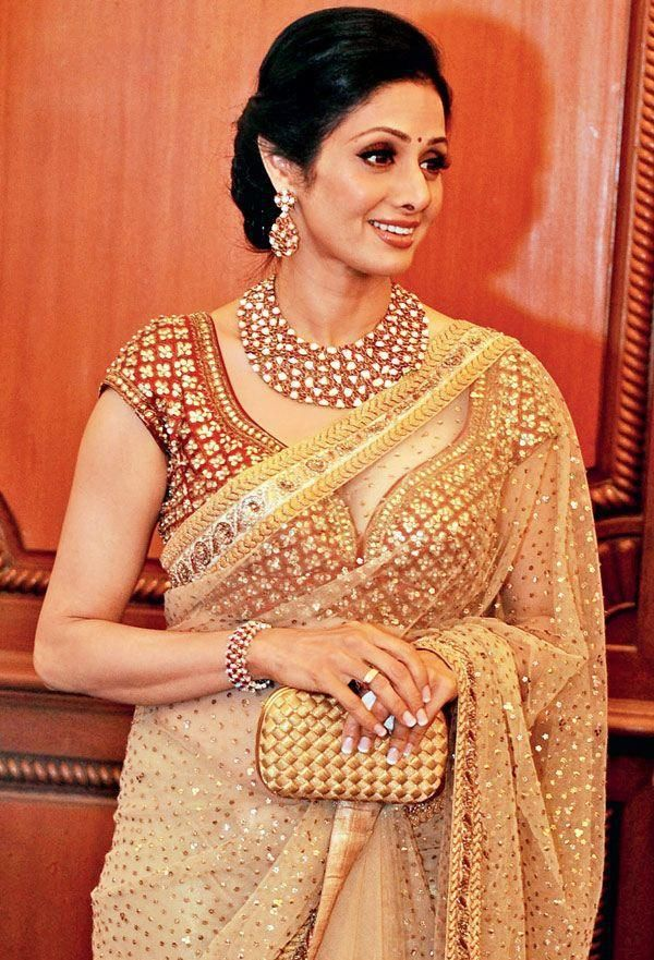 Sridevi in Sabyasachi - Gorgeous saree, blouse and jewels -- and not to mention, the Bottega Veneta clutch. :)