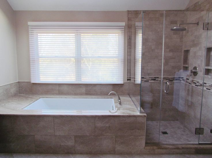 Gorgeous Tub Surround U0026 Shower Enclosure Which Uses Porcelain Tile That  Mimics The Appearance Of Stone With A Marble Feature Stripe.