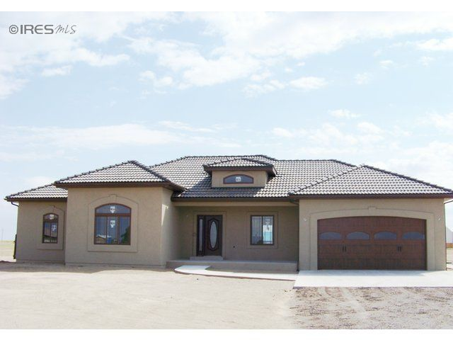 House plans ranch hip roof stucco property photo for for Hip roof garage