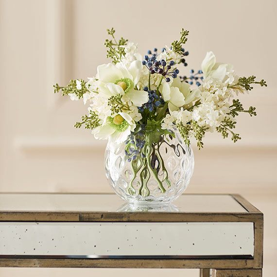 The Kingscote Anemone Bunch is a dainty posy of pretty white Japanese anemones and white lilacs, punctuated by blue dogwood berries. This small faux flower arrangement is perfect for a bedside table. Floral stylist Willow Crossley has hand-picked a selection of complementary individual faux flower stems, so you can create your own bunch at home. Arranged in one of our vases, our faux flowers look just like the real thing - we promise no-one will be able to tell the difference. Bunch…