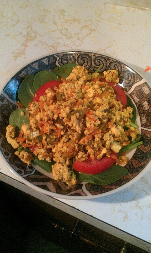 copycat of Amy's Tofu Scramble  reheats well. you can alter the veggies or spices to fit your tastebuds. drain and squeeze the heck out of the tofu..you'll be glad you did. :-)