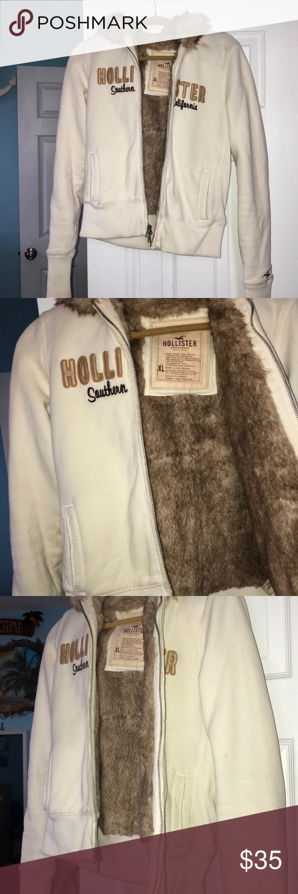 SALE🔥🔥 Hollister Jacket Very beautiful fur lined Hollister jacket. Super warm and very comfortable. Has been worn many times and is still in good condition with minor issues (shown in pics) but nothing a trip to the laundromat wouldn't spice up (I'm just too lazy to bring it especially since it doesn't fit me anymore!) definitely open to offers cause I want it gone! Hollister Jackets & Coats