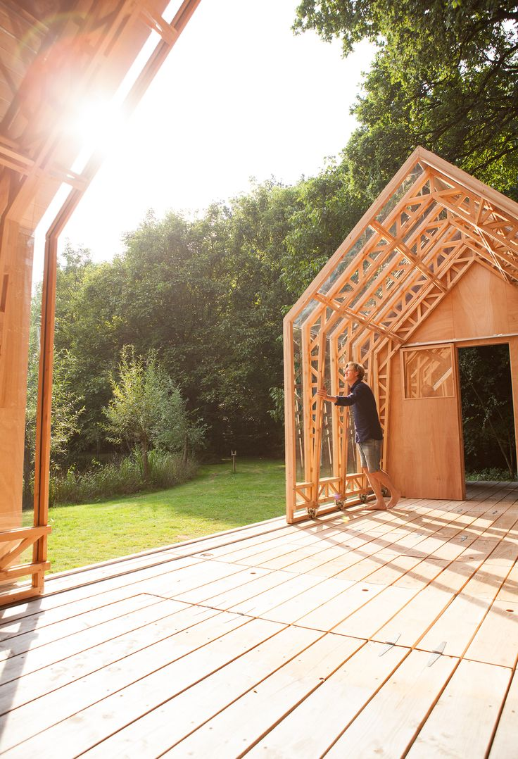 Layered timber and glass walls move along runners to reveal or enclose this gabled garden shed in Eindhoven, designed and built by Caspar Schols as a hobby space for his mother.