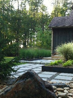 Front entry, stone work, patio steps, boulders, grasses, modern rustic country home. Completed by Leaf Garden Design Inc.  | brigden Rd