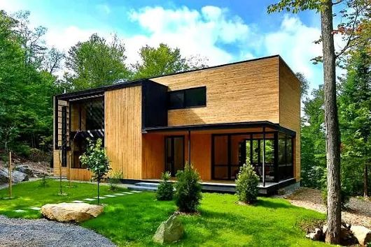 Casa de madera en el corazón del bosque Laurentian | ArQuitexs