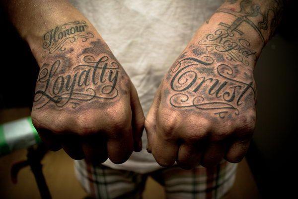 fancy script font hand tattoos 29