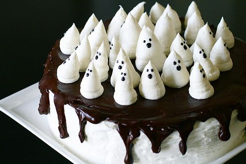 bootiful ghost cake-- chocolate cake with raspberry filling, frosted with vanilla buttercream and glazed with dark chocolate ganache.  Finally, the ghosts with a marshmallow frosting and a black powdered sugar glaze for the faces.