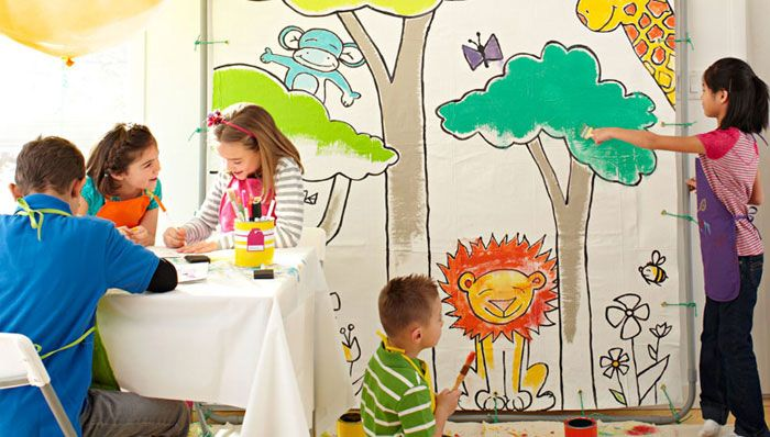 Kids with giant coloring page made from drop cloth - cheap, fun - great party idea then it can be made into all sorts of things... duvet cover, curtains, play tent... someday I'll have grandbabies :0)