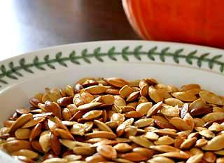Don't throw away the pumpkin seeds from your pumpkin!  Toast them in the oven for a delicious and healthy Halloween snack.  Toasted pumpkin seeds recipe.