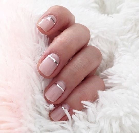 Pretty blush pink nude nails with a metallic silver accent stripe. Pretty pink a…