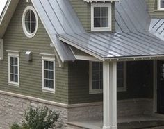 Olive green siding, gray metal roof, buff colored stone work.  Very interesting.: