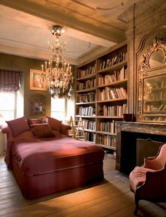 Chaise longue in library. Perfect place to read a good book. This library has it all for me: books, chaise, chandelier and fireplace ~ what else could one ask for? Axel Vervoordt