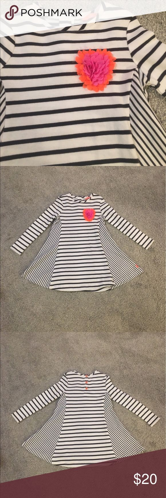 Joules Striped Girl's Dress NWOT. I absolutely love this dress; I think it's crazy adorable, unfortunately my daughter doesn't share the same sentiments, and it has never been worn. This long sleeved dress is white with black stripes and features a pink and orange heart on the front, button closure in back. Size 3-4 yr Joules Dresses