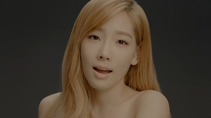 kim taeyeon of  snsd screenshot from their divine m  v