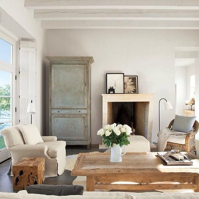 Rustic Coastal Living Room With White Beamed Ceilings