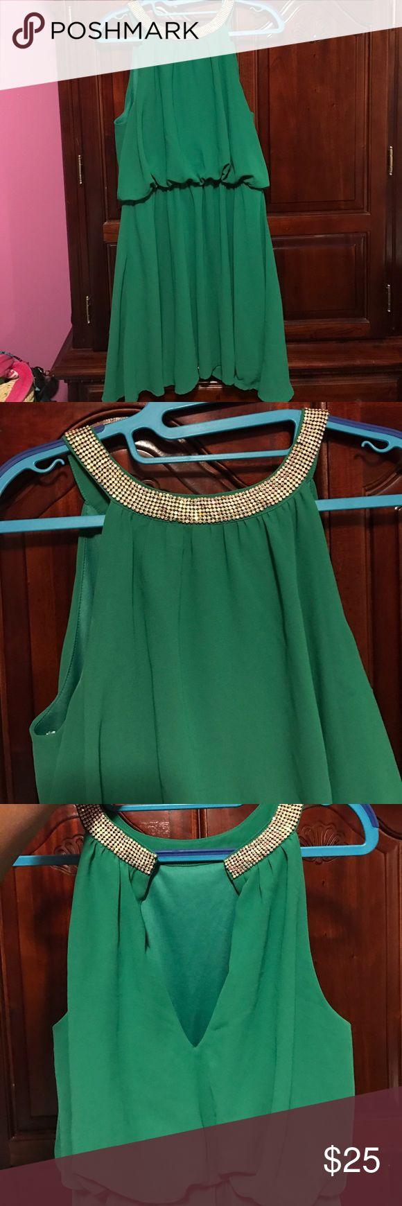 Green formal dress Short formal dress , the color is really nice on , the diamonds on the dress is still attached Dresses