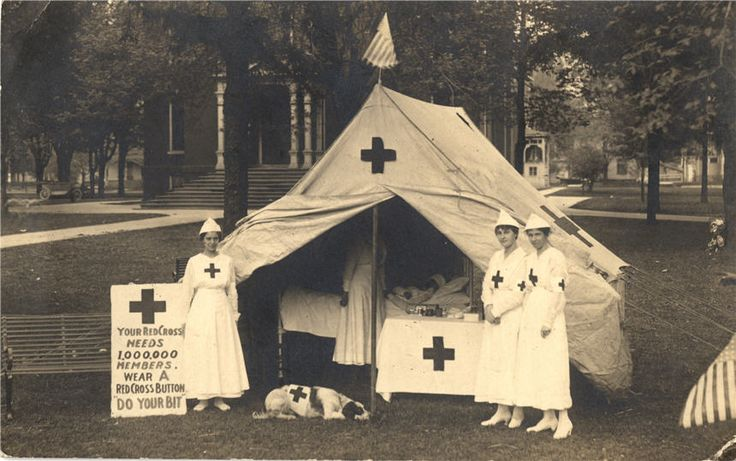 Nurses stand at a Red Cross recruiting tent in a park, United States, ca. 1918. Pictures of Nursing: The Zwerdling Postcard Collection. National Library of Medicine