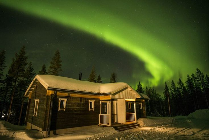 Northern Lights above the Ritavaara Valkea Arctic holiday village in Pello in Lapland