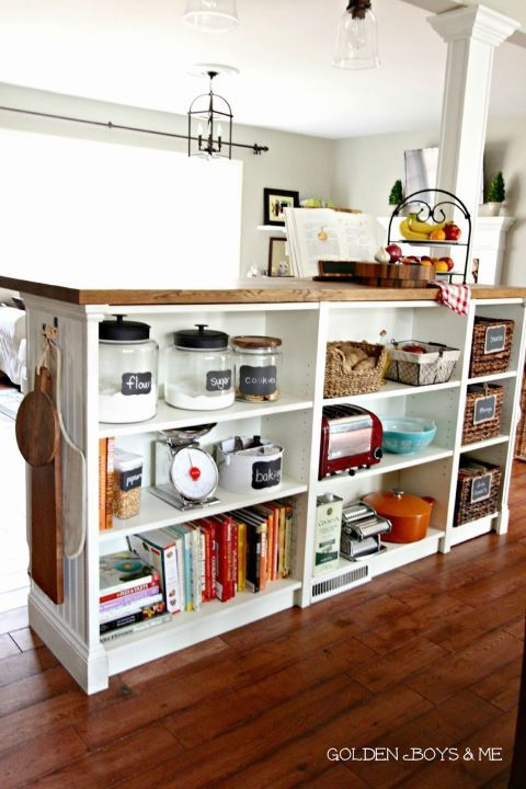 The bookshelf hack is kind of like the open shelving version of an island: The back is totally exposed and reveals organized compartments for baking supplies, books, and even snacks. See more at Golden Boys
