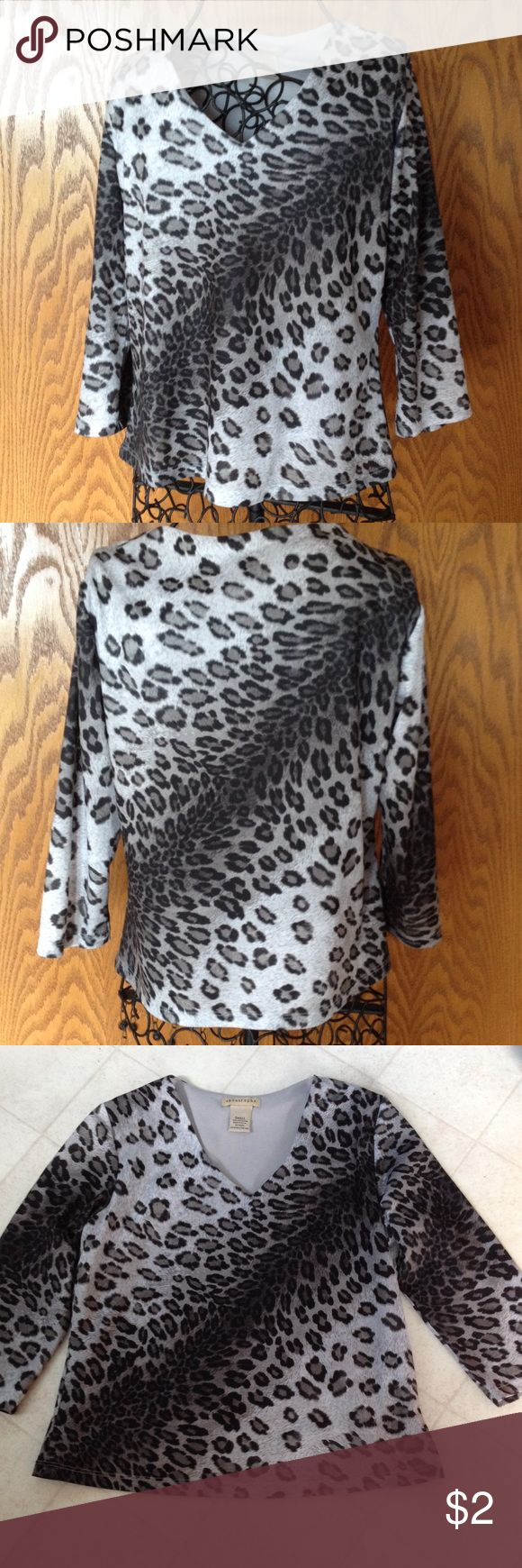 """Apostrophe animal print top with 3/4 sleeves V neck top is lined in front and back. 100% polyester and gently worn. Length is 20"""", across front is 17 1/2"""". Apostrophe Tops"""
