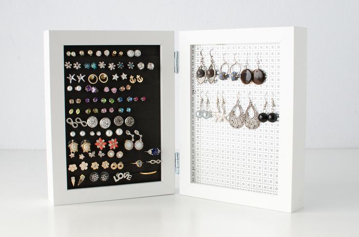 When it comes to store and display your HOOK and STUD earrings, this Double Framed Earring Organizer is your solution. I've taken 2- 5x7 White Frames and hinged them together for a beautiful display s
