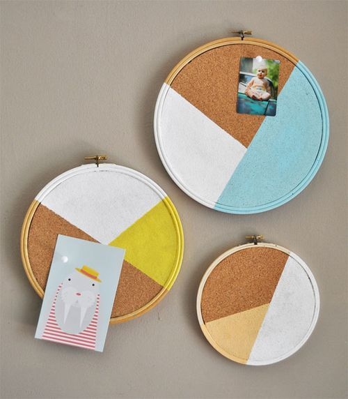 Give a cork board a dose of color. Get the how- tos here: http://paintmeplaid.com/2012/08/01/wednesdays-with-handmade-charlotte-diy-cork-board-messaging-hoops-with-folkart/