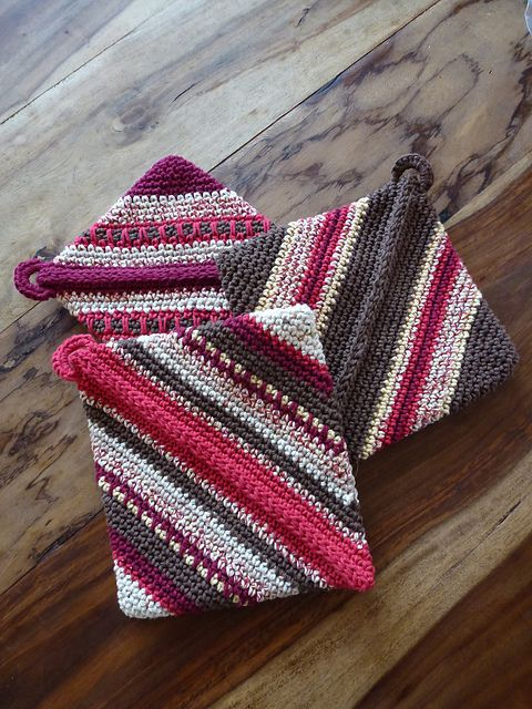 Diagonally Crocheted Potholder. Easy! As you crochet it magically folds in upon itself, one seam to close. Free pattern.
