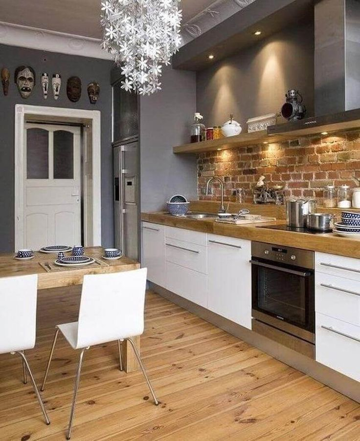 Slate gray kitchen with exposed brick backsplash