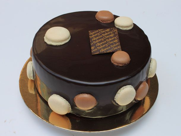 Big Anne: little hazelnut praline and chocolate mousse number covered in chocolate ganache and dotted with baby macarons from Alliance Bakery in Chicago