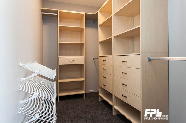 This large wardrobe from Wardrobes Direct (www.wardrobesdirect.co.nz) is fitted with drawers and shelving, providing ample space.