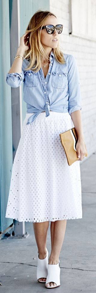 I love the look of a button down shirt over a pretty dress! Leave the top buttons open & tie the bottom