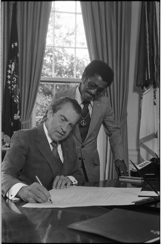 best president richard nixon first lady pat nixon images on president richard nixon signing a document at his desk in the oval office as sammy davis