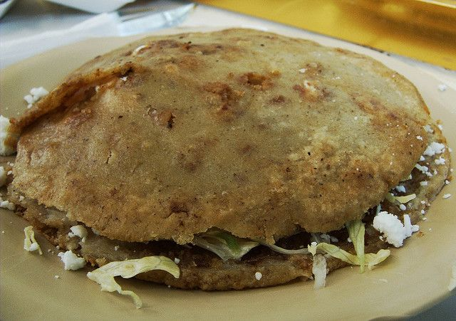 Gordita (Mexico). 'Gorditas are hand-held heaven, a puff  symphony to Mexican good taste. The cooked masa is split, then filled with minced (ground) pork, punchy chorizo or cheese and chillies. It's finished off with a sprinkling of shredded lettuce, chopped onion and the usual dollop of hot sauce.' http://www.lonelyplanet.com/mexico