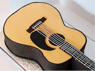 Martin Acoustic Guitar cake.  How cute is this. I'll have to remember this for Dwain's birthday