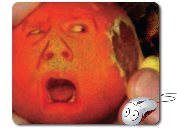 Funny Mouse Pad, Mousepad, Mouse Pad, Funny Art, Office Decor, Home Decor, Mousepad Funny, Office Gifts, Mouse Mat, Love Gift, Funny Gifts. Your desk and mouse will feel the love with these funny mousepad, 'Orange' man's head. Eyes. Nose and an open mouth with teeth and tongue screaming when a person's hand peel the shell on it ear.