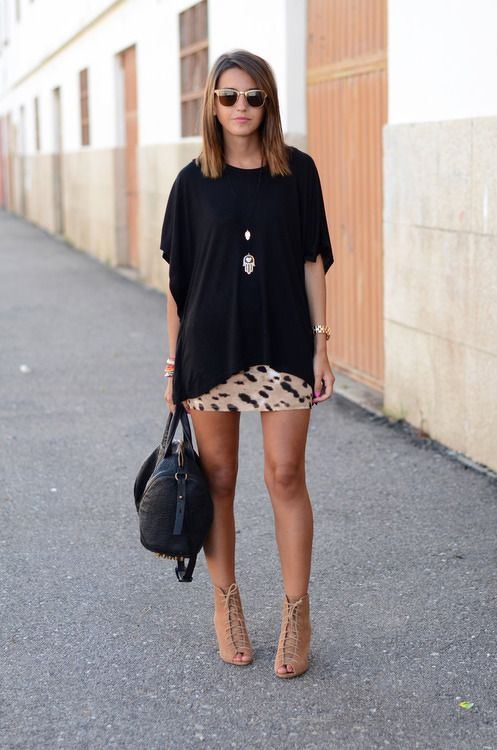 Not sure what to wear with a mini skirt? Try pairing it with an oversized top or sweater and a long necklace for a chic look.