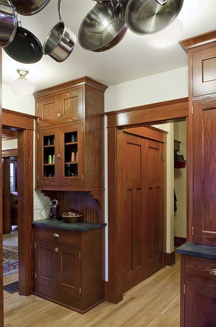 Craftsman kitchen -- love the closet doors in the adjacent hallway -- house remodeled by Craftsman Design & Renovation