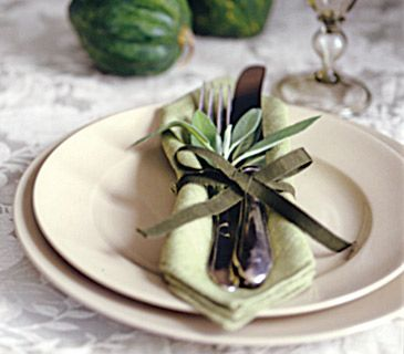 Natural elements can be surprising additions, whether as centerpieces or tucked into a pretty ribbon fastening the silverware.