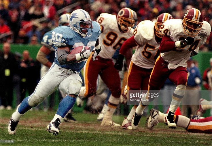 Detroit Lions running back Barry Sanders (20) runs for yardage against the Washington Redskins at Jack Kent Cooke Stadium. Sanders, apparently fed up with the Detroit Lions'' mediocre record and coach Bobby Ross, will retire from the NFL, his agent told ESPN Tuesday July 27, 1999.
