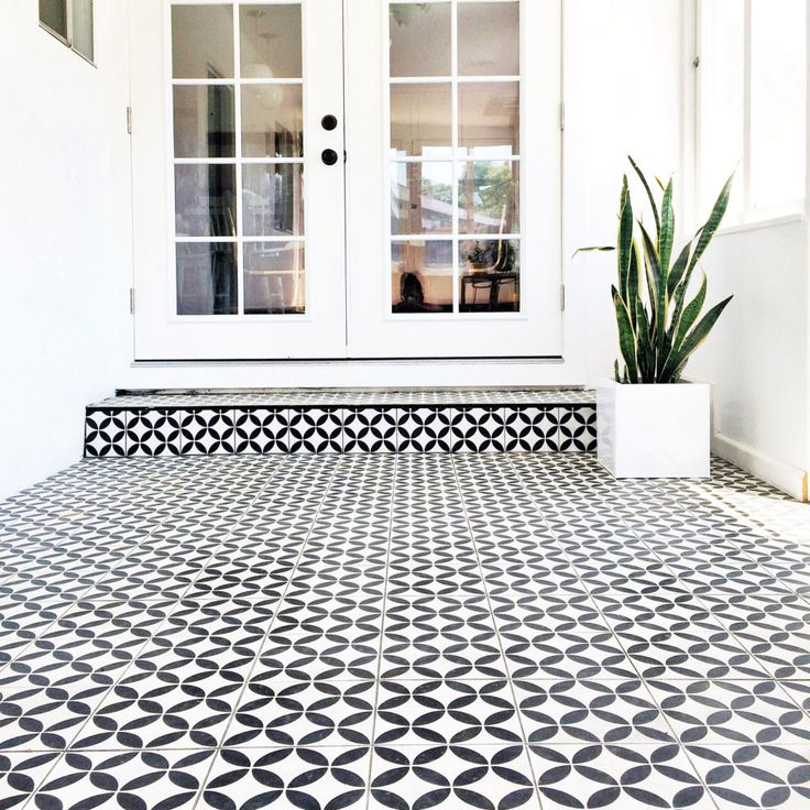 bright california sunroom remodel with black white cement tile built in slat bench seating