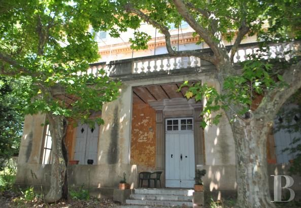 An 18th century, traditional Bastide house awaiting renovation, with 3.5 ha of land to be farmed and a view of Toulon harbour, near Sanary - character properties France - in Provence, Languedoc-Roussillon, Côte d'Azur, Upper-Savoie - Patrice Besse Castles and Mansions of France is a Paris based real-estate agency specialised in the sale of Character houses.